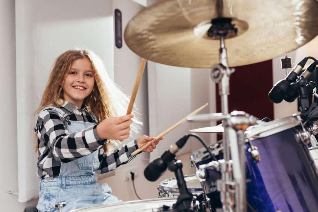 Female Beginner Taking Drum Lessons