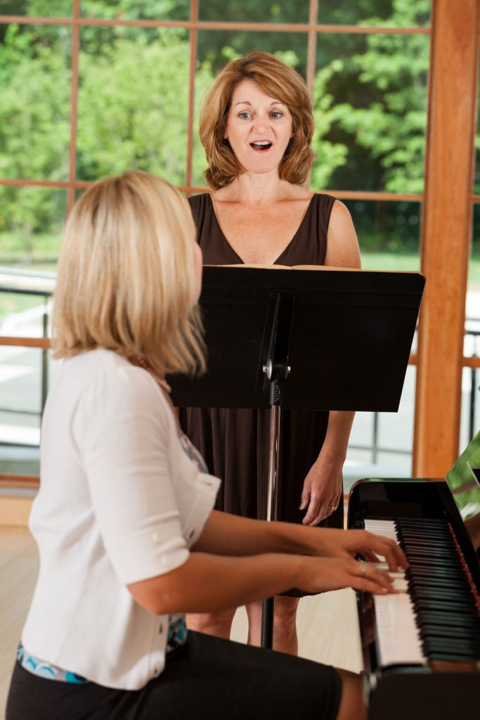 voice instructor giving voice lesson to her student