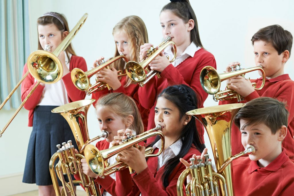 group of kids playing brass instruments