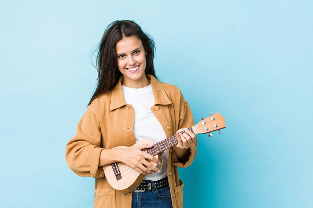 young smiling woman with ukulele